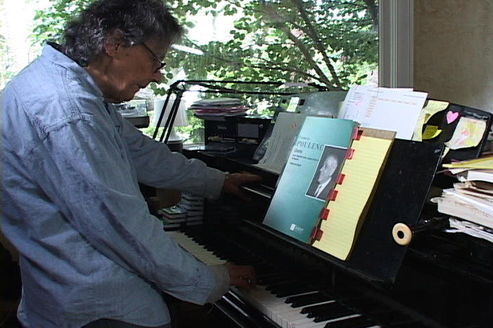 Arlene Sagan explains tritones at her piano.