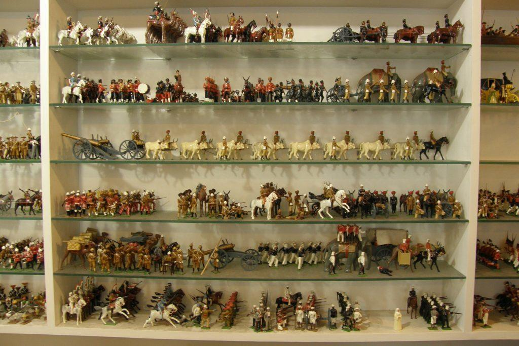 Bill Hocker's historical miniatures — just one cabinet of many. Photo by Linda Morris.