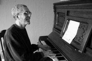 Photo of Ken at the piano