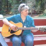 Mary Rogier and her trusty guitar