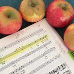 Score of Bach's St. John Passion and honey crisp apples