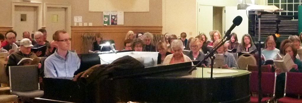 Photo of accompanist Collin Whitfield at piano