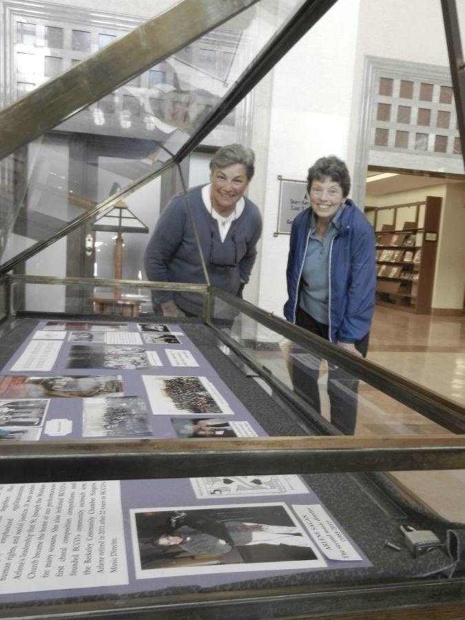 Joanna Davenport and Patti Powers-Risius inspect a display case at the Berkeley Public Library