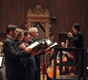Brian Thorsett sings Elijah with conductor Ming Luke. Photo by Bill Hocker.