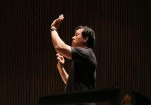 BCCO conductor Ming Luke rehearses before a performance. Photo by Bill Hocker.