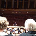 Inside Dvorak Hall, Prague, Ming Luke conducting BCCO rehearsal. Photo by Nancy Sue Brink