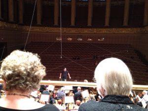 Inside Dvorak Hall, Prague, Ming Luke conducting BCCO rehearsal. Photo by Nancy Sue Brink